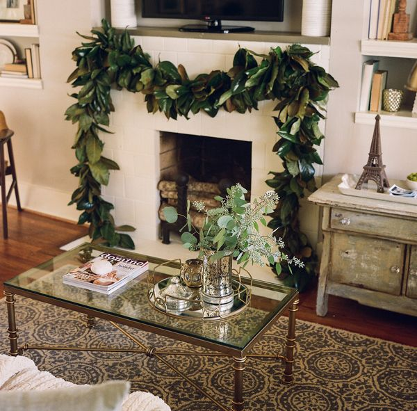 Southern newlywed home for the holidays with abby and for Christmas garland on fireplace