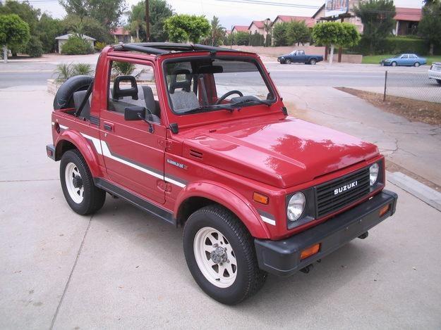 this is the car i drove in college a red suzuki samurai