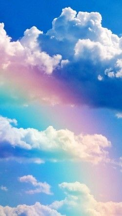 A transparent rainbow against the clouds.