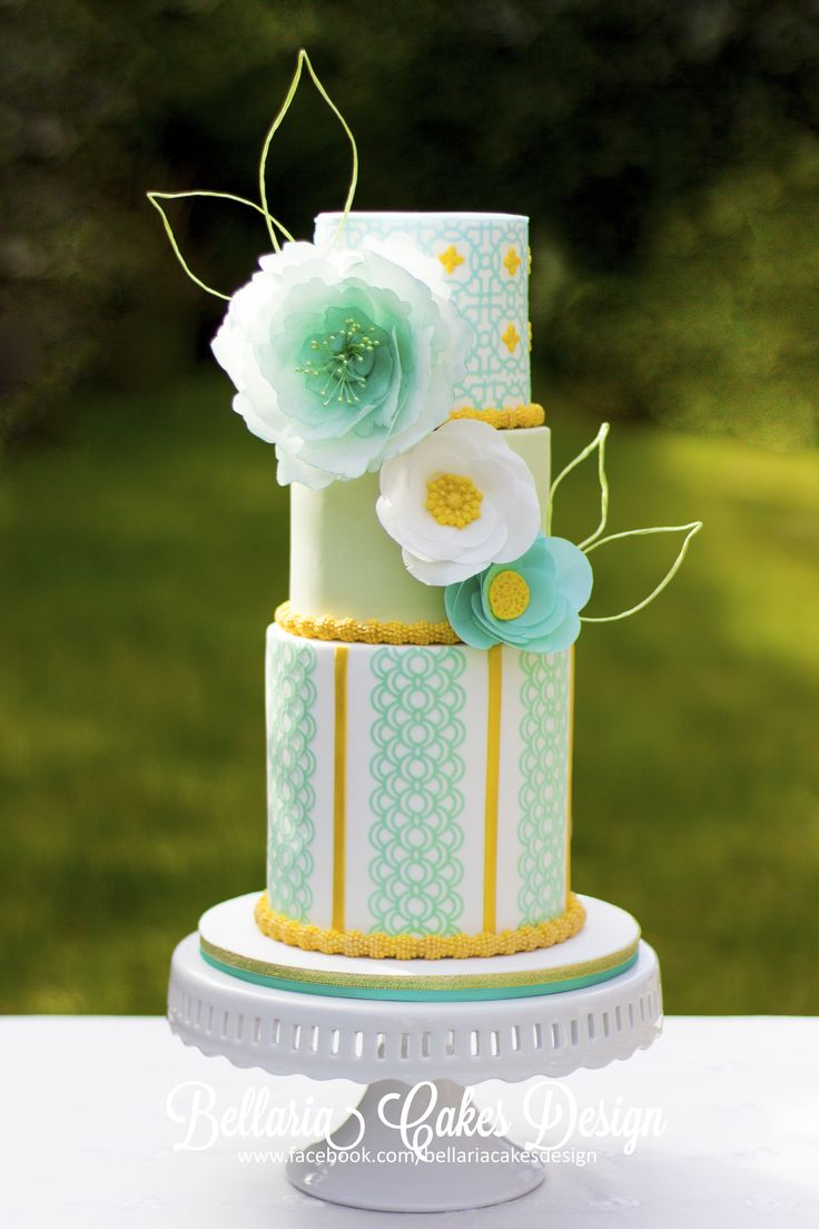 Spring gold and leaf green wedding cake - Spring gold and leaf green wedding cake with wafer-paper flower. I made the pattern from wafferpaper also and love the color combination. Spring is in the air !  XXX Riany
