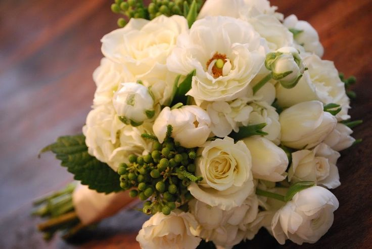 some samples i did for an upcoming bride. all white flowers which include hydrangea, ranuculus, tulips and roses with texture from berzill...