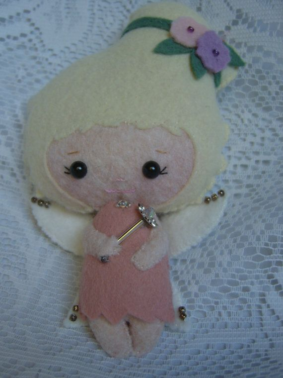This is an adorable little blonde Kawaii wool felt fairy/angel doll - a Gingermelon pattern!!  She is entirely hand-sewn in wool felt, has safety eyes, and some tiny seed beads added to her wings and flowers in her hair. She even holds a tiny fairy wand that has a pretty crystal bead!! She stands about 5 tall. Ships by USPS Priority Flat Rate Small Box Thank you so much for taking a peek