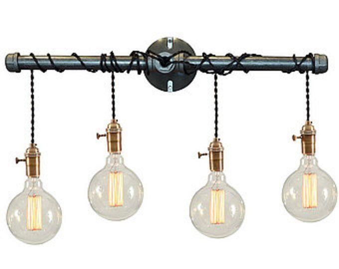 DESCRIPCIÓN: Esta luz industrial es lo suficientemente flexible como para trabajar en un hogar, espacio comercial u oficina. Está diseñado para parecerse a un grifo de agua con una gota de agua.  ~ TODAS LAS LUCES PUEDEN SER MODIFICADO PARA REQUISITOS PARTICULARES. SI QUIERES ALGO PERSONALIZADO A SUS NECESIDADES, POR FAVOR HÁGANOSLO SABER Y LE COTIZAMOS.  DETALLES DEL ARTÍCULO: -Dimensiones: 11  H x 8 W -Bulbos: Cualquier estilo bulbo como Edison, estándar, LEDS etc. (no candelabros)…