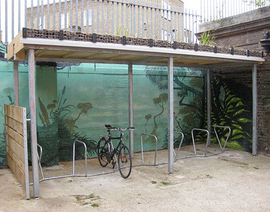 covered bike parking a must!  and a green roof to boot, what's not to love?