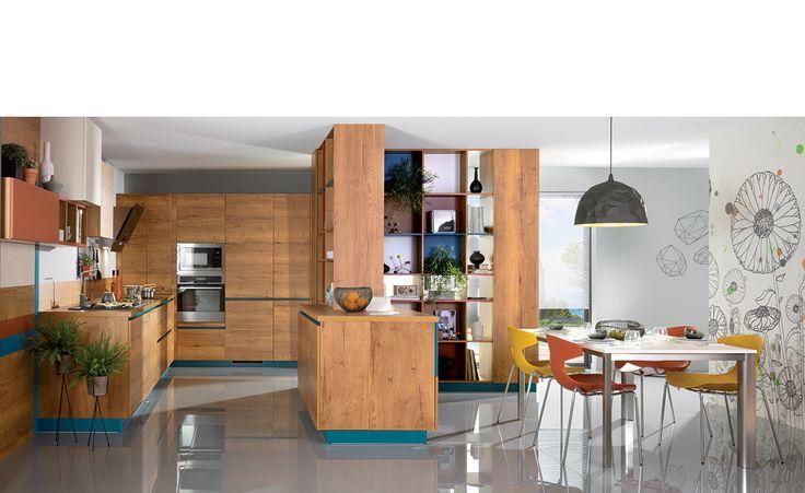 Cuisine Design - Arcos Eolis Vertica. Vaste espace ouvert esprit 50's, gai et coloré. Une véritable pièce à vivre, conviviale, pensée pour une grande famille. La circulation s'organise autour de la bibliothèque double face à la fois paroi de séparation et rangement des plus pratiques.