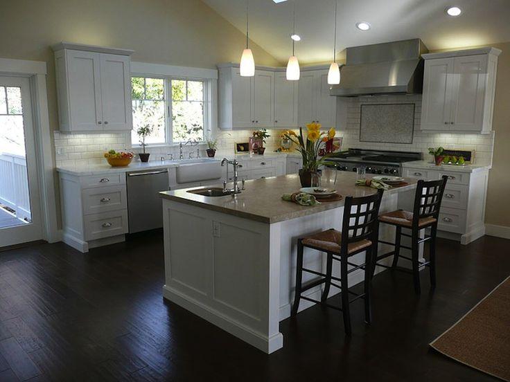 Love dark floor/white kitchen. Love olde style sink + huge stove/oven + breakfast counter