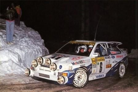 François Delecour with Daniel Grataloup driving their Ford Escort RS Cosworth to win the 1994 Monte Carlo Rally.