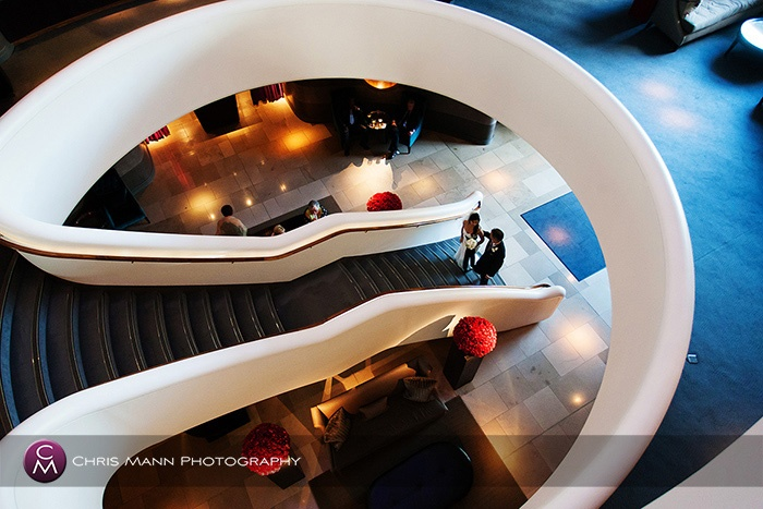 Bride and groom on the staircase at the Aviator Hotel Farnborough