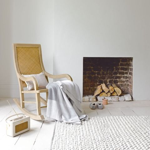 ROCKER. This nostalgic rocking chair didn't so much fly through our design auditions but cantered through them! Made of lovely weathered birch wood with handwoven rattan.