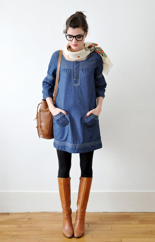 I think this one just awesome.  simple blue dress, tan boots, black tight, scarf off to the side (love), nerdy glasses