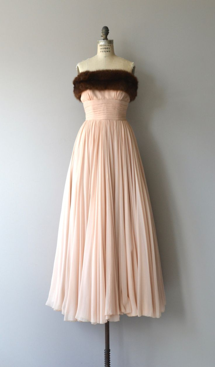 Beyond beautiful 1950s pale blush pink layers of silk chiffon with wide warm brown mink bodice, cummerbund wrapped fitted waist, corset boning along with some expert interior construction and back zip closure.   --- M E A S U R E M E N T S ---  fits like: small bust: 34 waist: 26 hip: free length: 52 brand/maker: n/a condition: excellent  ★ layaway is available for this item  to ensure a good fit, please read the sizing guide: http://www.etsy.com/shop/DearGolden/policy  ✩ more vintage…