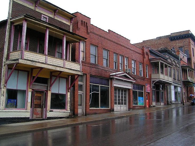 Main street inside abandoned town that was supposed to be Site B of Catherine and Henry Black's plan to repopulate the United States post-Bad Sam  (Shawnee, Ohio abandoned main street)