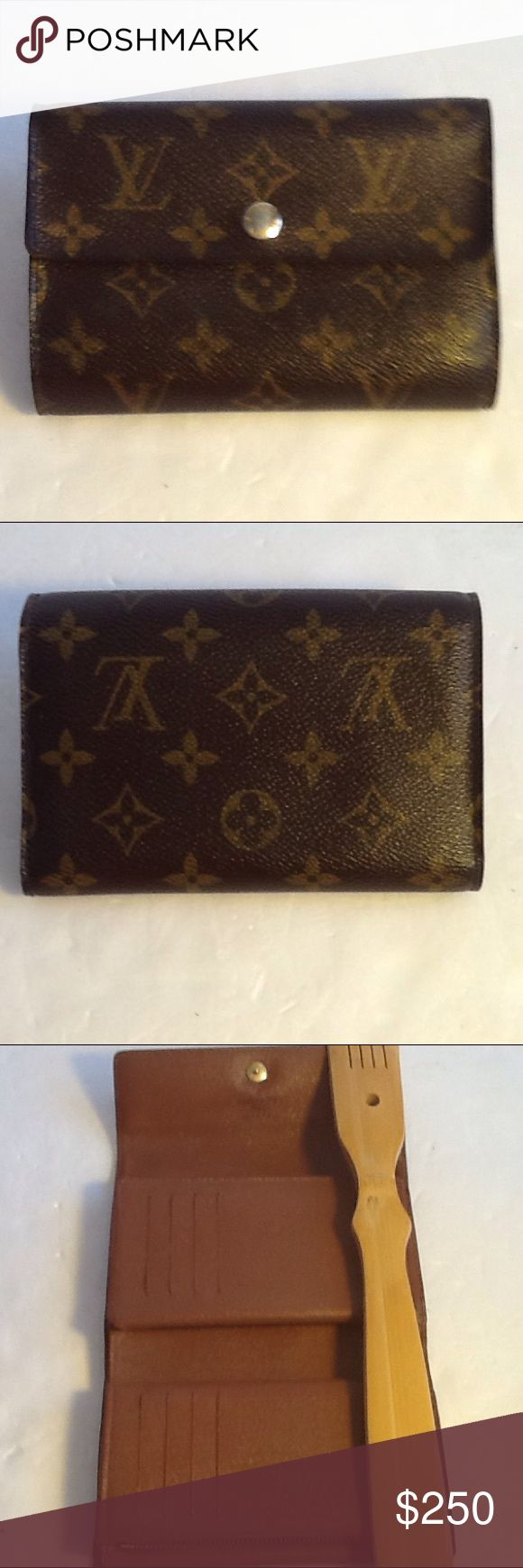 Authentic Louis Vuitton Bifold Multi Pocket Wallet Leather and canvas showed light wearing. The wallet was bade in France. With a date code SP 0087. Over all the wallet us in s good condition. Louis Vuitton Accessories