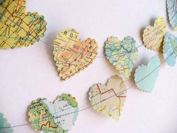 world map garland...just cut the hearts from a world map and sew them together to make unique garland for a long distance themed wedding