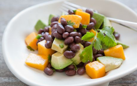 Mango, Avocado and Black Bean Salad // Tropical flavors of mango and citrus complement black beans in this colorful salad. It's a delicious vegan option!