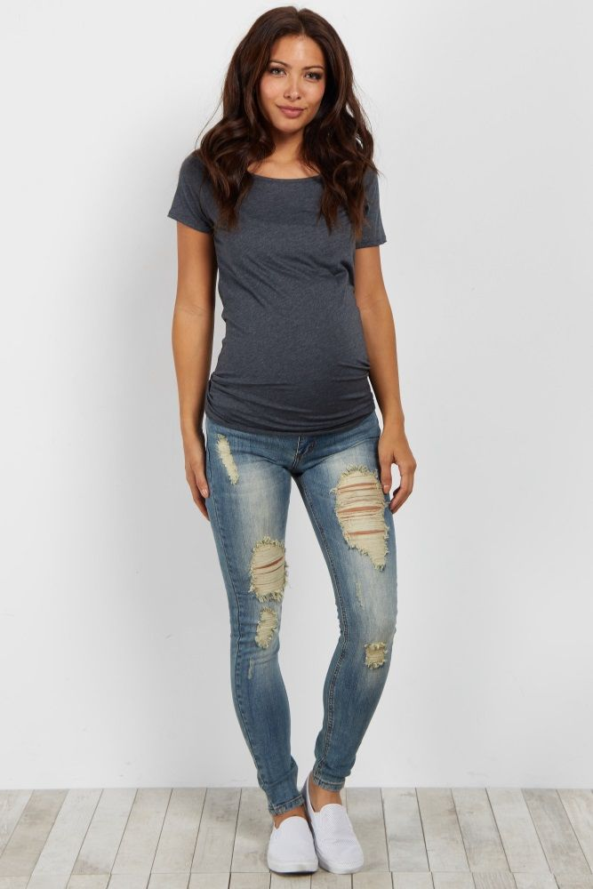 A must-have maternity essential for every season, these faded destroyed maternity skinny jeans will not only fit perfectly, but will keep you comfortable all day long. Style these with your favorite maternity top and boots for the complete chic look.