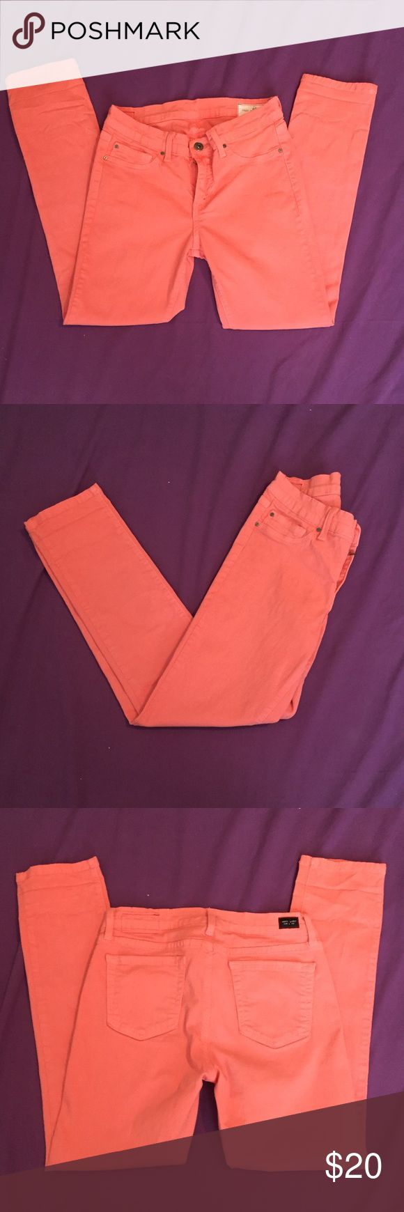 Coral colored skinny jeans Boutique style coral colored skinny jeans in size 27. In great condition. Perfect for spring!! Pants Skinny