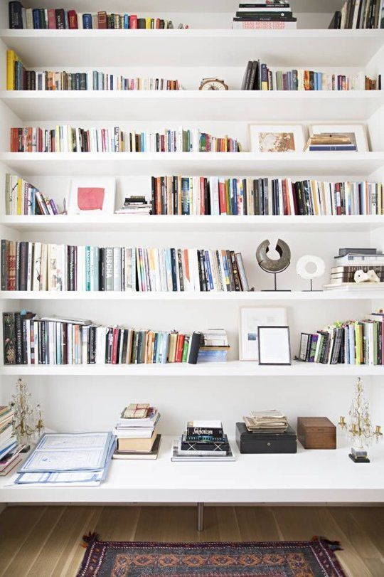 Small Space Secrets: Swap Your Bookcases for Wall Mounted Shelving.   Good idea to have a bench underneath.