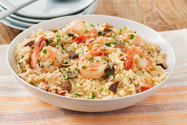 As you know, real risotto is tasty but takes forever. Our version, made with instant rice and shrimp, is ready to serve in under an hour.
