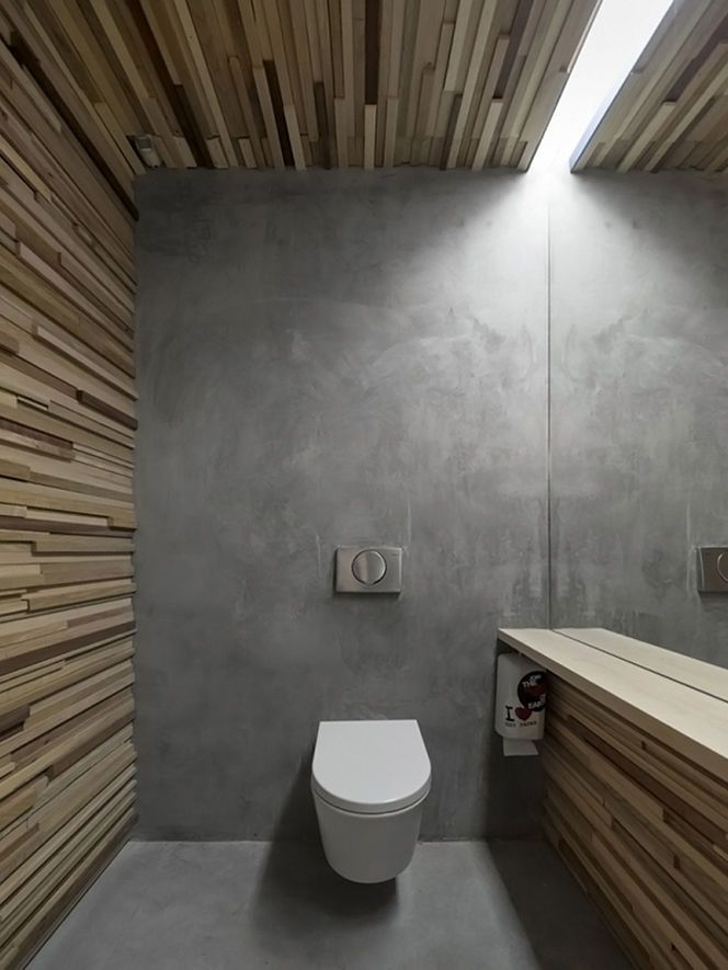 Contemporary WC with Wood Paneled Walls and Polished Concrete Floor