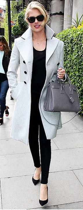 Kate Upton: Coat – Vivienne Westwood  Purse – Saint Laurent