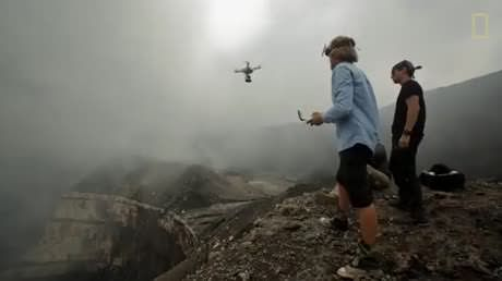 Flying a drone to a volcano.