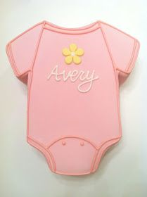 A onesie cake is perfect for a baby shower! Here's one that we personalized with the baby's name and a cute little flower.