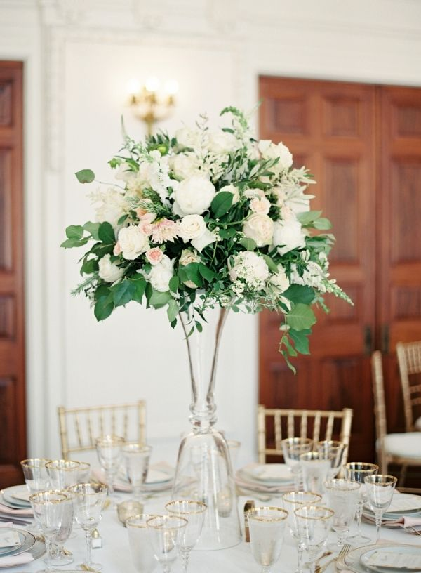 Tall floral centerpieces that wow: http://www.stylemepretty.com/2016/02/10/trending-high-centerpieces-thatll-wow-your-guests/