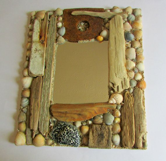 This is one of our handmade, unique driftwood mirrors. Please visit our shop, Limpet Lane, at www.etsy.com for full details.