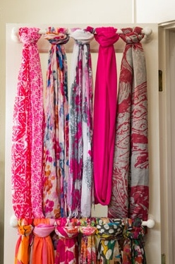 I love this scarf storage organizer idea.  Scarves are tied on towel rack that is mounted on closet door.
