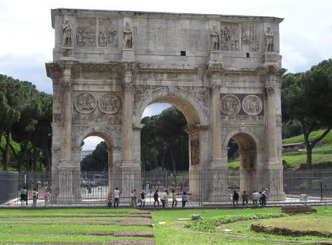 The Arch of Constantine (Arco di Constantino) is located next to the Coliseum in Rome Italy.  Erected to commemorate Constantine's military victory at the Battle of the Milvian Bridge in 312 AD, the arch is over 25 meters high.