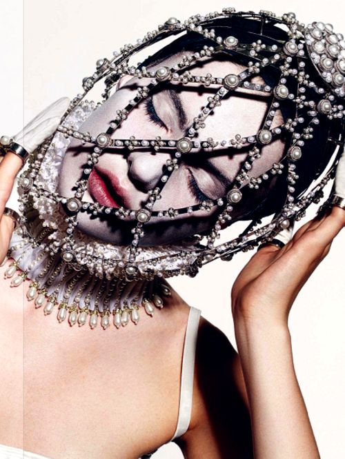 Applying Marie Antoinette make-up through a face cage is difficult, but worthwhile. Vogue Italia August 2013