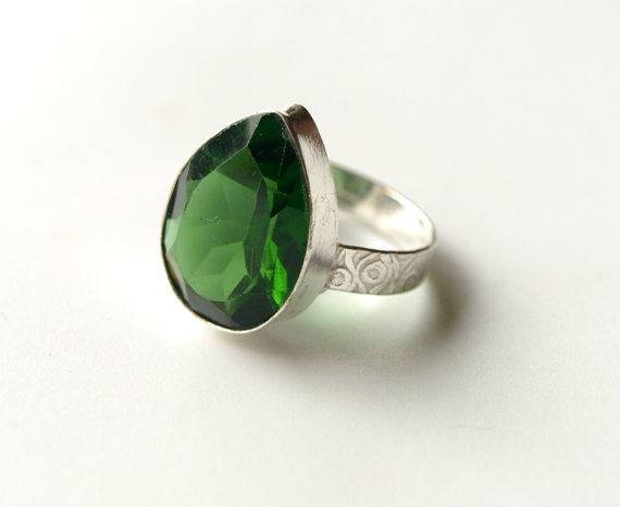 Green! This is chromium diopside. I have one of these darlings- and it is the loveliest bottle-green sparklie ever!!!