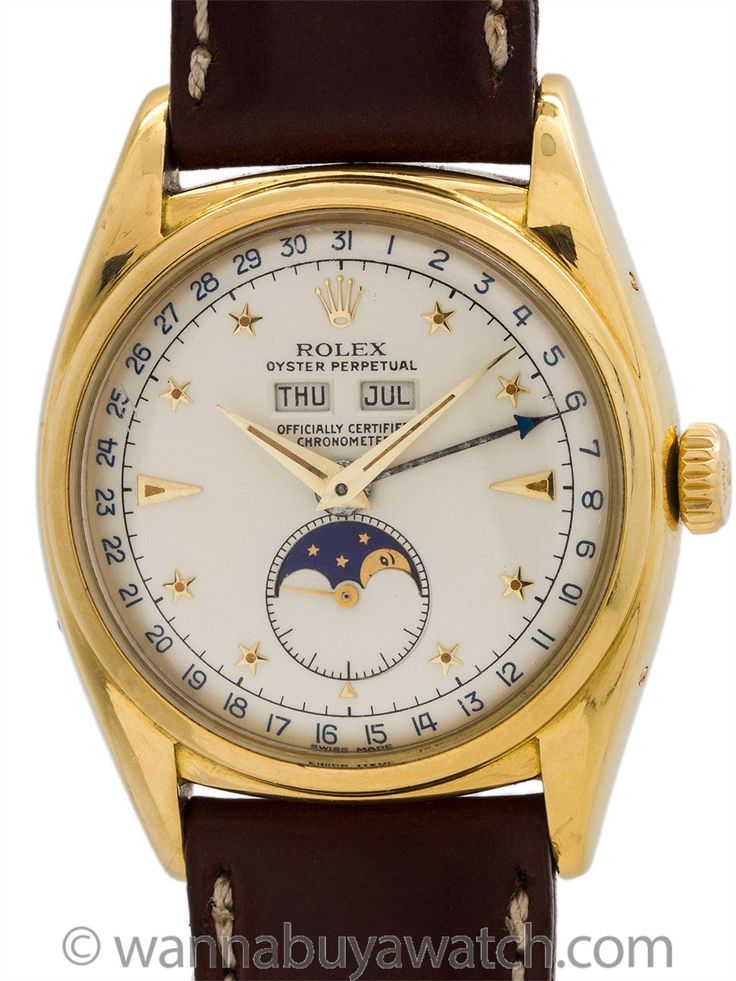 """Rolex ref 6062 Oyster Moonphase Star Dial """"Stelline"""" 18K YG circa 1952 - A very rare and pleasing ref 6062 Rolex 18K YG Moonphase """"Stelline"""" calendar model case serial# 911,xxx circa 1952 with star index dial. One of the rarest and most desirable of all vintage Rolex models, this model features a beautifully restored matte silver dial with applied star indexes and Rolex logo crown, blue printed calendar scale, and rich navy blue and gold moon phase disk. Powered by caliber 655 self winding…"""