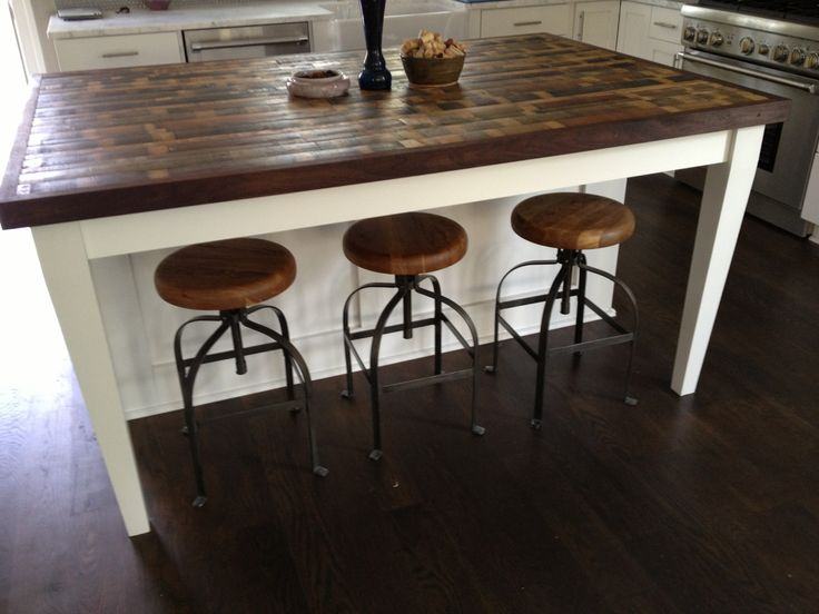 Thinking about this instead of kitchen table...love it! Match cabinets the stain on top i think id leave the bottom white/off white though