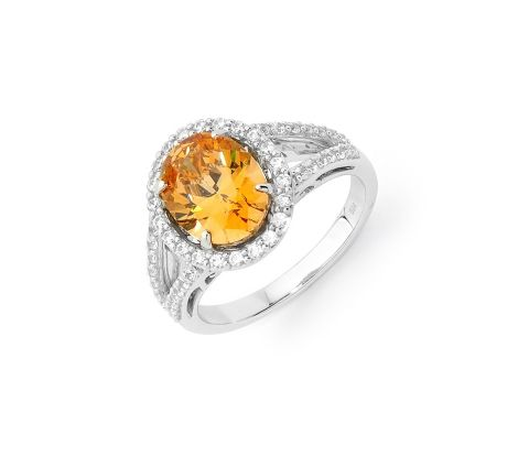 Beautifully crafted, this Expressions sterling silver amber colour & white cubic zirconia oval cluster dress ring is made with SWAROVSKI ZIRCONIA and features a 10mm amber stone surrounded by 50 smaller stones. Traditional in design, this ring will sparkle and shine through its vibrant colour and smooth polished finish.