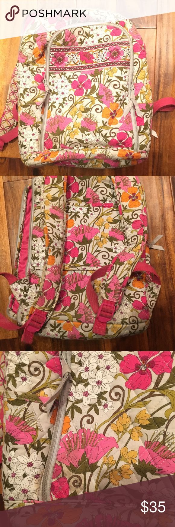 Vera Bradley laptop backpack Vera Bradley laptop back pack! Used for only one school year. Decent condition and clean. One dark spot on front and tear on the inside of the shoulder strap that isn't noticeable when worn! Reasonable offers excepted Vera Bradley Bags Backpacks