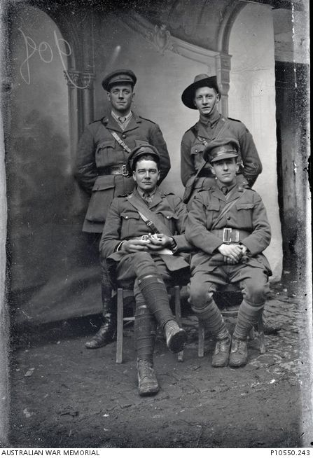 Group portrait of 4 officers from 5th Battalion. Back, l to r: unidentified; 1911 Lieutenant (Lt) Alexander Fulford Bechervaise MC. Front: Captain Thomas Karran MALTBY; Lt John William Dwyer.