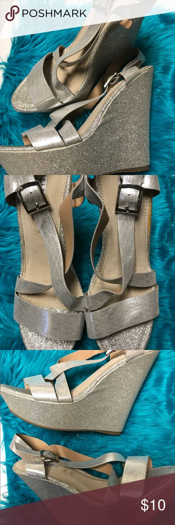 Metallic Silver Wedge sandals Sz 10 Gently Used!! Sz 10. A little extra sparkle goes a long way with these crystal embellished high heel wedge sandals! Wedge sandals are decorated with fine Metallic crystals. Shoes Wedges