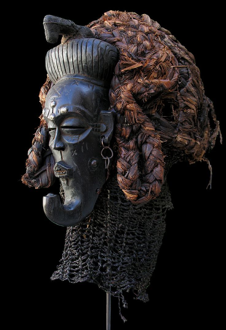 Africa | Female 'Pwo' mask from the Chokwe people of Angola and DR Congo | Wood, pigment, metal and natural fiber