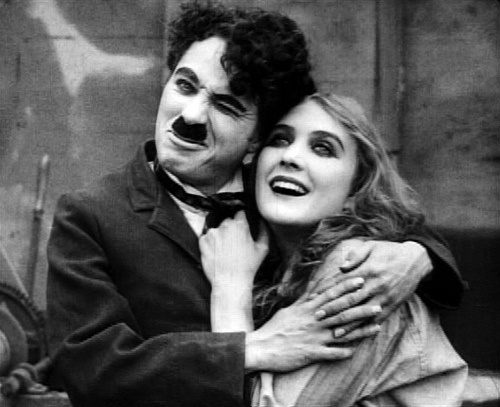 Edna Purviance and Charlie Chaplin