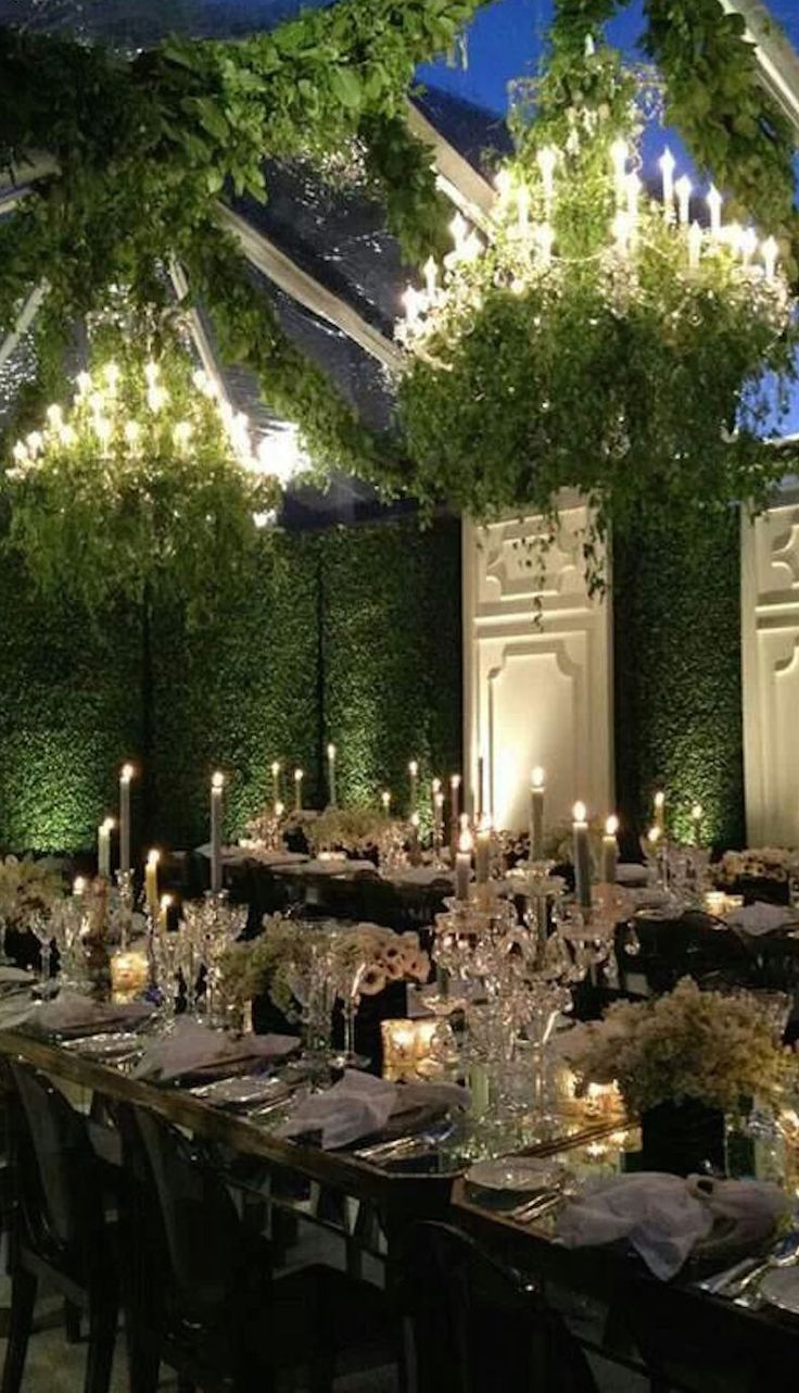 994 best chandeliers tree hangings images on pinterest wedding for an indoor garden wedding crystal candelabras chandeliers heavy with greenery and walls of foliage arubaitofo Images