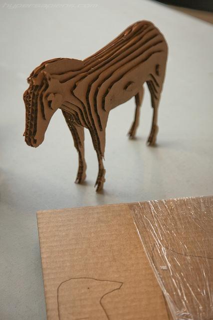 Laser cut cardboard models.