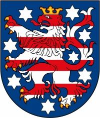 The coat of arms of Thuringen or Thuringia features a blue shield on which a gold-crowned and gold-clawed lion (whose color consists of eight alternating red and white horizontal stripes) is depicted. Eight white stars are also depicted on the shield, which some believe are symbolic of the eight historical divisions of the state. It was adopted in 1990, but its design derives from the arms of Landgrave Conrad from the 13th century.