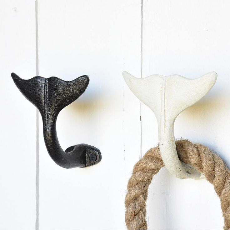 Whale Tale Hooks! Perfect for entry ways, kitchens or for creating a fun beach house bathroom - http://www.caronsbeachhouse.com/whale-tail-black-iron-hooks-set-of-2/