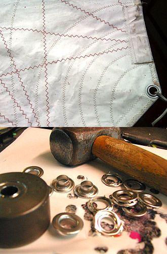 【Material】  ●Eyelet●  〜本物のアイレット(はとめ)ヨットのセイルの三角のそれぞれコーナーに打ち開けられたものと同じステンレス製のリアルアイレットを使っています。