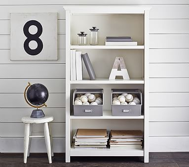 I saw this in store and its not so high, so we just have to decide on what dimensions we like, 3 or 4 shelf book shelf. I have the swatches for white and grey and we can put the grey up to the chair and see…