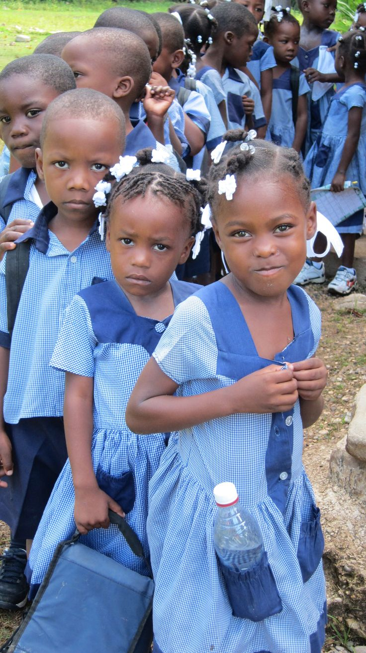 These children in Haiti are going to school. Most Haitian children have to walk long distances to get to school.