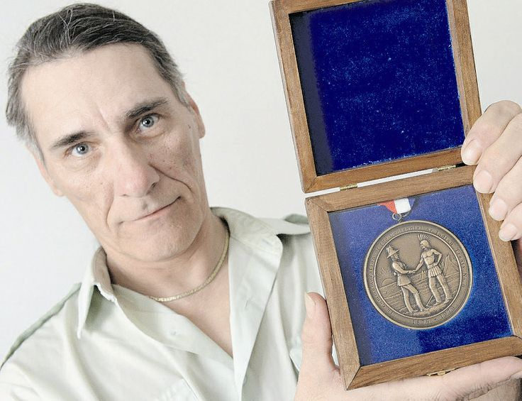 Man rescues treaty medal from the trash