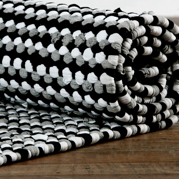 Black and white rug. Looks crocheted, not woven.